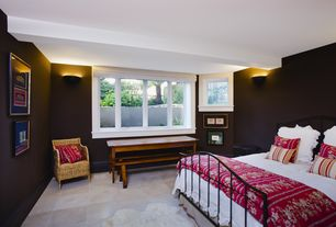 Cottage Guest Bedroom with Wall sconce, simple marble tile floors