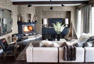 Contemporary Living Room with metal fireplace, Pendant light, interior wallpaper, Hardwood floors