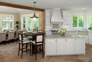 Modern Kitchen with Kitchen island, Framed Partial Panel, stone tile floors, Farmhouse sink, L-shaped, Custom hood, Casement