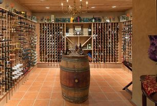 Eclectic Wine Cellar with Built-in bookshelf, can lights, Chandelier, Standard height, terracotta tile floors