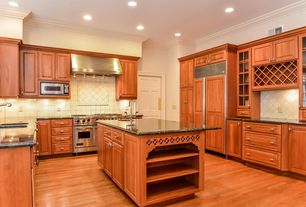 Traditional Kitchen with High ceiling, Framed Partial Panel, double oven range, Wall Hood, full backsplash, Kitchen island
