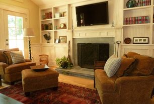 Country Living Room with Laminate floors, Built-in bookshelf, specialty window, High ceiling, French doors, stone fireplace