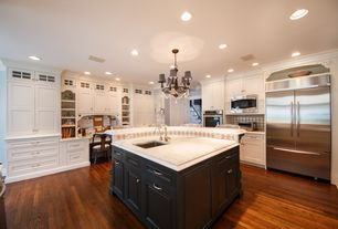 Traditional Kitchen with Large Ceramic Tile, specialty door, Crown molding, Glass panel, Undermount sink, Kitchen island