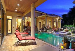 Mediterranean Swimming Pool with Fence, Transom window, Pool with hot tub, exterior stone floors, Raised beds, French doors
