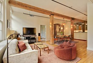Modern Living Room with Wall sconce, Crate & Barrel Montage Media Stand, Hardwood floors, Exposed beam, Built-in bookshelf