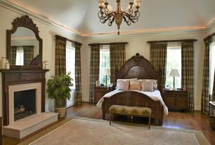 Traditional Master Bedroom with Fireplace, Casement, Crown molding, Standard height, insert fireplace, Hardwood floors