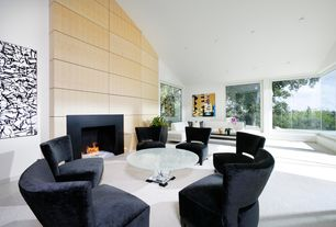 Modern Living Room with metal fireplace, Paint, Carpet, Fireplace, High ceiling, picture window, can lights