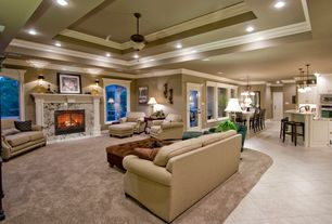 Traditional Great Room with Ceiling fan, Crown molding, Fireplace, picture window, can lights, flat door, French doors
