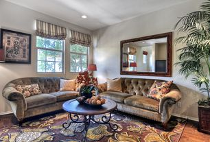 Mediterranean Living Room with Hardwood floors, double-hung window, Standard height, can lights
