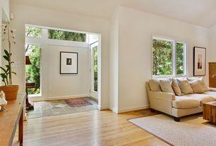 Modern Entryway with Glass panel door, Standard height, Hardwood floors, picture window