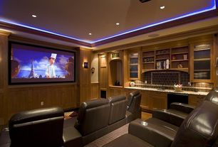 Craftsman Home Theater with Wainscotting, Carpet, Hollywood Crown Molding for Indirect Lighting, Crown molding