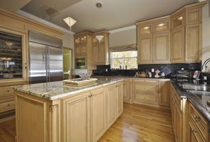 Traditional Kitchen with Glass panel, Crown molding, Undermount sink, Soapstone counters, Raised panel, U-shaped, Soapstone