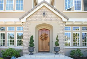 Traditional Front Door with exterior tile floors, Transom window, exterior terracotta tile floors
