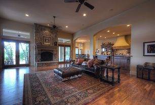 Traditional Living Room with Hardwood floors, Ceiling fan, Transom window, can lights, Fireplace, insert fireplace