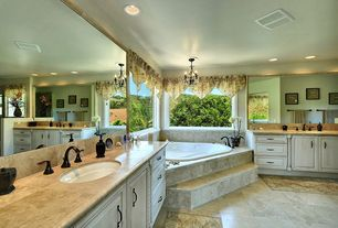 Traditional Master Bathroom with Stone Tile, simple marble tile counters, Chandelier, Master bathroom, Undermount sink