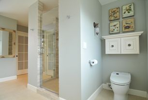 Traditional Master Bathroom with frameless showerdoor, Wall sconce, Vinyl floors, French doors, Raised panel
