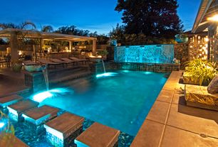 Traditional Swimming Pool with Trellis, Lap pool, Fence, Fountain, Outdoor kitchen, Outdoor lounge chair, Fire pit