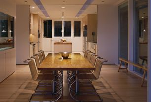 Contemporary Dining Room with Laminate floors