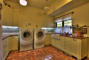 Eclectic Laundry Room with Farmhouse sink, High ceiling, terracotta tile floors, Randolph morris fireclay sink, Pendant light