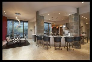 Contemporary Dining Room with Built-in bookshelf, Concrete tile , Pendant light