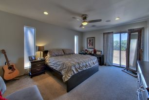 Contemporary Master Bedroom with Carpet, Ceiling fan, Built-in bookshelf
