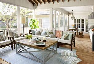 Cottage Living Room with Green Hydrangea, Diamond Light Blue/Ivory Indoor/Outdoor Rug, Carpet, Fence, Hardwood floors