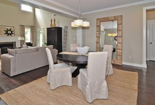 Modern Dining Room with Hardwood floors, Pendant light, Crown molding