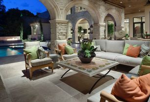 Traditional Porch with Fire pit, French doors, Transom window, exterior stone floors