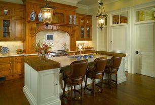 Traditional Kitchen with Limestone counters, Crown molding, Louvered door, Undermount sink, Custom hood, full backsplash
