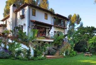 Mediterranean Exterior of Home with Pathway, French doors, Fence