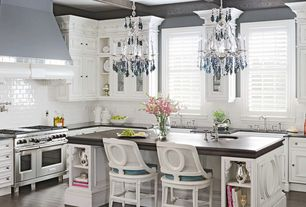 Traditional Kitchen with Standard height, double oven range, Soapstone counters, Undermount sink, Exposed beam, Chandelier