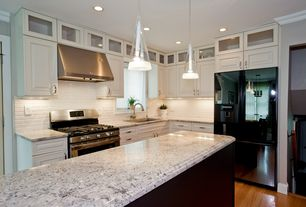 Modern Kitchen with Crown molding, L-shaped, Glass panel, Flush, Simple granite counters, Pendant light, Subway Tile
