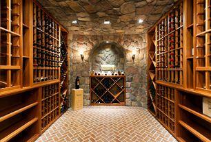 Rustic Wine Cellar with Built-in bookshelf, herringbone tile floors, Wall sconce