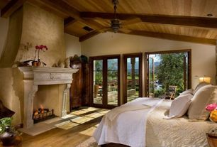 Master Bedroom with Exposed beam, French doors, Elmwood reclaimed antique heart pine wood paneling, can lights, Ceiling fan