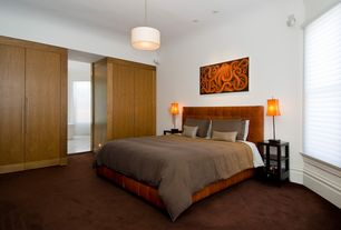 Contemporary Master Bedroom with can lights, Built-in bookshelf, Carpet, Standard height, Pendant light