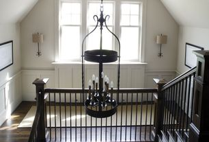 Country Hallway with Hardwood floors, Wall sconce, Wainscotting