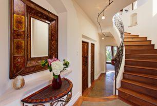 Mediterranean Entryway with Concrete floors, Pendant light, High ceiling