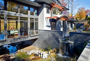 Contemporary Landscape/Yard with Trellis, Fountain, exterior stone floors, Pond
