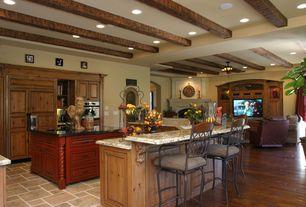 Mediterranean Kitchen with Kesir Travertine Tile - Antique Pattern Sets Volcano Standard, Canyon Creek Gettysburg Cabinetry