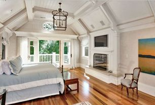 Traditional Master Bedroom with High ceiling, Mazama Hardwood - Tigerwood Premiere, Hardwood floors, Crown molding, Fireplace