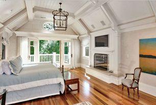 Traditional Master Bedroom with Crown molding, Chandelier, Mazama Hardwood - Tigerwood Premiere, Hardwood floors, Box ceiling