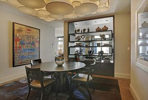 Modern Dining Room with Standard height, Built-in bookshelf, can lights, Hardwood floors, Chandelier
