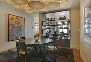 Modern Dining Room with Standard height, can lights, Built-in bookshelf, Hardwood floors, Chandelier