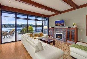 Contemporary Living Room with Hardwood floors, Crown molding, Exposed beam, Built-in bookshelf, Transom window