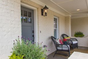 Craftsman Front Door with Outdoor wicker furniture, Painted brick wall, Covered front porch