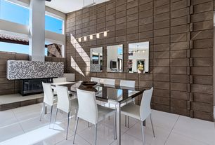 Contemporary Dining Room with Fireplace, Pendant light, High ceiling, sandstone tile floors, stone tile floors