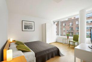 Contemporary Master Bedroom with Hardwood floors, Columns, Built-in bookshelf
