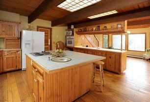 Craftsman Kitchen with Flush, Wainscotting, Skylight, Breakfast bar, L-shaped, Flat panel cabinets, Louvered door