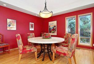 Craftsman Dining Room with Crown molding, Pendant light, Standard height, Hardwood floors, Casement, can lights