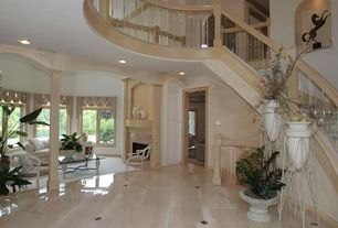 Traditional Entryway with simple marble floors, Columns, can lights, Standard height